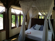Balinese style outdoor bedroom, Elegance and refinement Indonesian style Royalty Free Stock Photography
