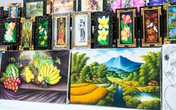 Balinese style painting exhibition in art gallery. Bali oil painting being sold at art center stock photos
