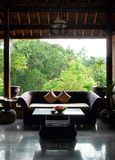 Balinese style patio sitting room. A colour photograph picture of a beautiful bali traditional style architecture with wood and bamboo furniture.  Showing Royalty Free Stock Photography