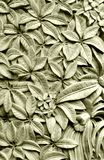 Balinese Style Stone Carving, Plumeria Flowers Stock Photo