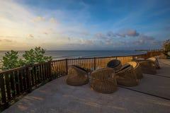 Balinese sunset. Beautiful modern terrace lounge in the sunset Royalty Free Stock Photo