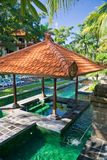 Balinese swimming pool. Traditional public pool on Bali, Indonesia Stock Image