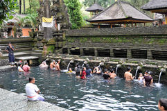 Balinese at tampaksiring temple. Balinese in sacred water at tampaksiring temple Royalty Free Stock Photography