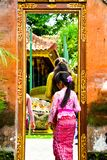 A Balinese teenage girl wearing traditional local clothing entering a sacred temple stock images