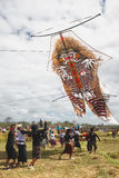 Balinese teenagers launching huge kite Royalty Free Stock Photography