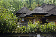 Balinese temple. Roofs on tropical forest background Royalty Free Stock Photography