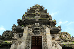 Balinese temple entrance with intricate stone carving. Intricate stone carved front of Pura Kehen Balinese Temple in Bali Indonesia royalty free stock photo