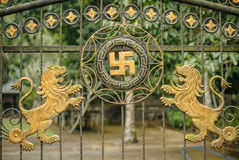 Balinese temple gate with Swastica and two lions. Stock Images