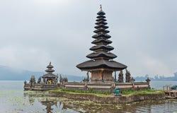 Balinese temple in lake Stock Photos
