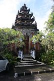 Balinese temple. A photo of a traditional Balinese temple taken from street view. Frangipani trees surround the entrance Royalty Free Stock Photography