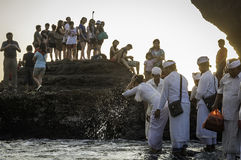 Balinese traditional ceremony at Old Tanah Lot temple Stock Photos