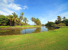 Balinese tropical park with golf. Beautiful tropical park at Bali, Indonesia Royalty Free Stock Image