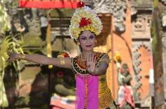 Balinese waman performs Barong and Kris Dance Stock Images