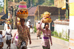 Balinese Woman Carrying Offerings On Her Head Stock Images