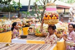 Balinese Woman Carrying Offerings On Her Head Royalty Free Stock Image