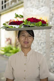 Balinese woman carrying tray on head royalty free stock photo