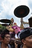 Balinese woman dressed in traditional clothes carried on a chariot in Ubud, Bali during the Royal family funeral 2nd March 2018 stock image