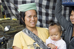 Balinese woman and kid. Friendly balinese woman and daughter royalty free stock photo