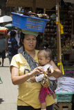 Balinese woman and kid selling souvenirs. At Ubud Art Market, Bali Indonesia royalty free stock photos