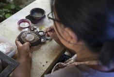 Balinese woman making handmade jewellery Royalty Free Stock Photography