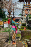 Balinese woman making offerings in the temple, Ubud, Bali Stock Photos