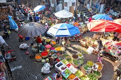 Balinese woman in market sell flower petals for everyday offering Royalty Free Stock Photography