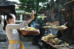 Balinese woman praying Stock Photos