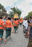 Balinese women bring offerings to the temple for the Ngaben ceremony for the funeral of an Ubud Royal Family member 2nd March 2018 royalty free stock photography