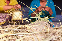 Balinese women make baskets for offerings Royalty Free Stock Photography