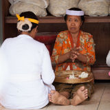 Balinese women make sweets for offerings Stock Photo