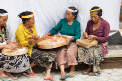 Balinese women make sweets for offerings Stock Images