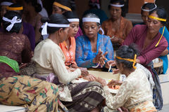 Balinese women make sweets for offerings Royalty Free Stock Images