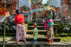 Balinese women making offerings in the temple, Ubud, Bali Stock Image