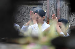 Balinese women in prayer. Balinese in prayer in tampaksiring temple Royalty Free Stock Image
