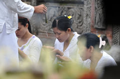 Balinese women in prayer. Balinese in prayer at tampaksiring temple Royalty Free Stock Images