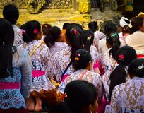 Balinese women taking a bath with holy water a sacred temple royalty free stock images