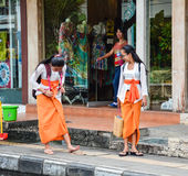 Balinese women walking on street in Bali, Indonesia Stock Photography