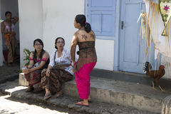 Balinese women in yard stock photo