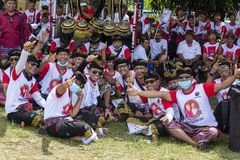 Balinese young guys participates in a street ceremony, during a pre-election rally, the Indonesian Democratic Party of Struggle in. GIANYAR, INDONESIA - JANUARY Stock Photo