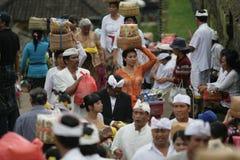 Balinesse women bring goods in her head Stock Photos