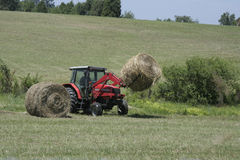 Baling Hay. Farming in East Tennessee is a major idustry. Here's an example of baling hay, one of the many chores necessary to sustain a livelihood Stock Photos