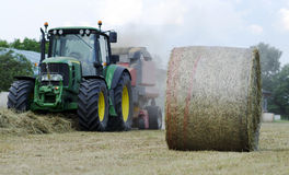 Baling hay in field royalty free stock images