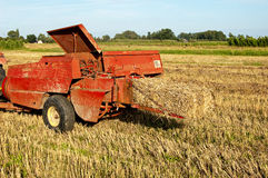 Baling hay in filed Royalty Free Stock Photo