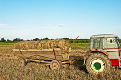 Baling hay in filed Stock Images