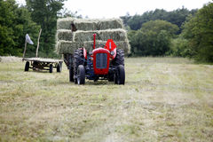 Baling hay in filed Royalty Free Stock Photography