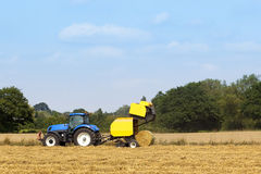 Baling machine and tractor Stock Image