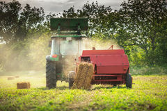 Baling tractor in the field Royalty Free Stock Photography