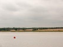 Balise rouge au paysage de mer aucune personnes Images stock