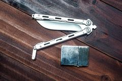 Balisong knife and lighter Royalty Free Stock Photo
