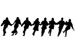 Balkan dancers silhouettes. Silhouettes of dancers performing a folklore dance Stock Image